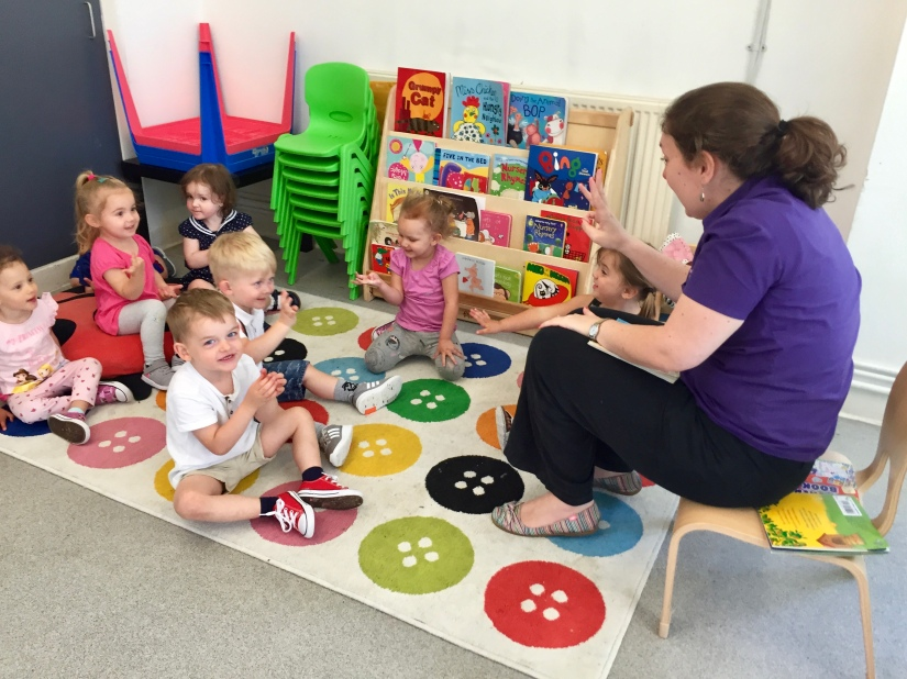 Children sing nursery rhymes at Polkadots nursery